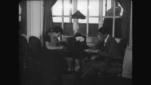 vidéos et rushes de people sitting at desks writing letters in the writing room, one of the the public spaces on the ship. the rms olympic is a sister ship of the rms... - titanic