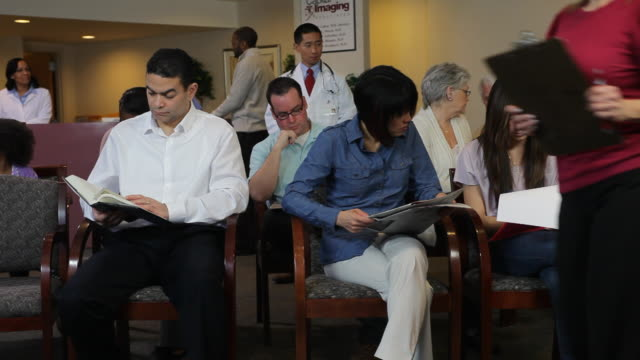 WS PAN People sitting at hospital waiting room / Albany, New York, United States
