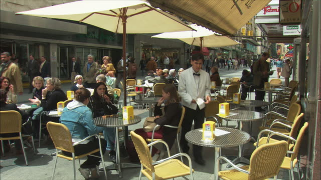 WS People sitting at outdoor cafe tables, Madrid, Spain