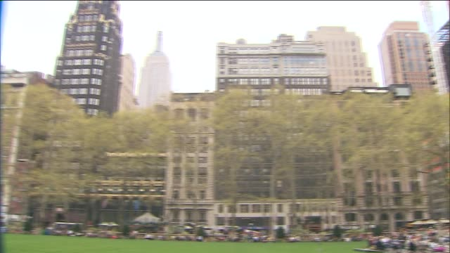 people sitting at tables on carousel lawn in front of new york public library at bryant park on may 03 2014 in new york city - bryant park stock videos and b-roll footage