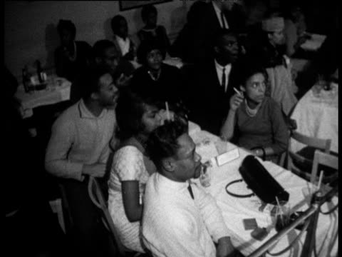 vídeos de stock, filmes e b-roll de people sitting at tables watching people dancing 'hully gully' in harlem nightclub new york 1960's - harlem