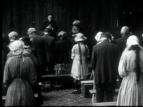 1916 B/W WS People sitting down, praying in church, 1880s / Santa Monica, California, USA