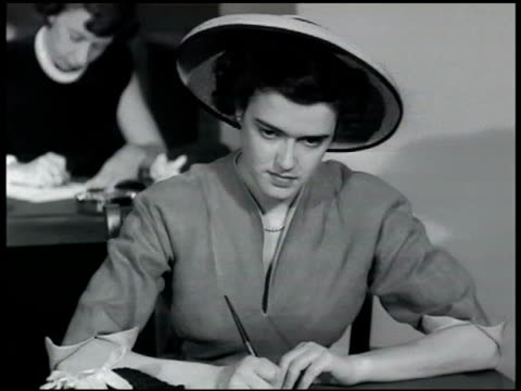 stockvideo's en b-roll-footage met people sitting in personnel office waiting room sign w/ arrow 'personnel department' three career women sitting on couch young adult female filling... - 1948