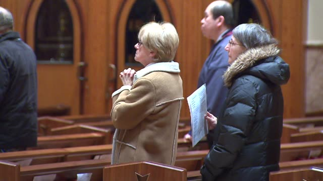 wgn people sitting in pews inside holy name church on march 12 2013 in chicago illinois - congregation stock videos & royalty-free footage