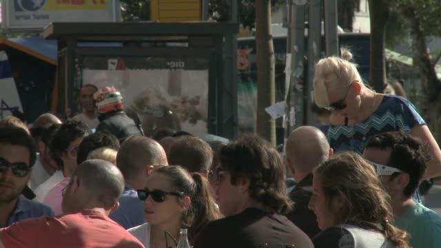 cu people sitting in sidewalk cafe / tel aviv, israel - tel aviv stock videos & royalty-free footage