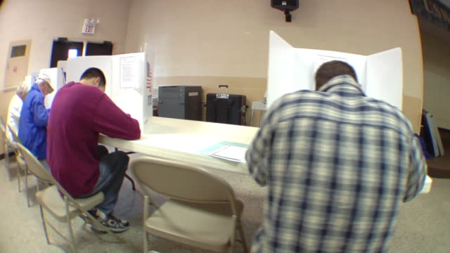 ms, pan, people sitting in voting booths at polling place, st. marys, ohio, usa - voting booth stock videos & royalty-free footage