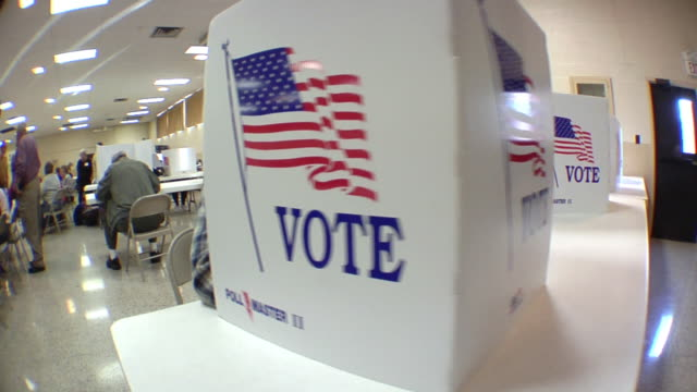 ms, pan, people sitting in voting booths at polling place, st. marys, ohio, usa - 投票点の映像素材/bロール