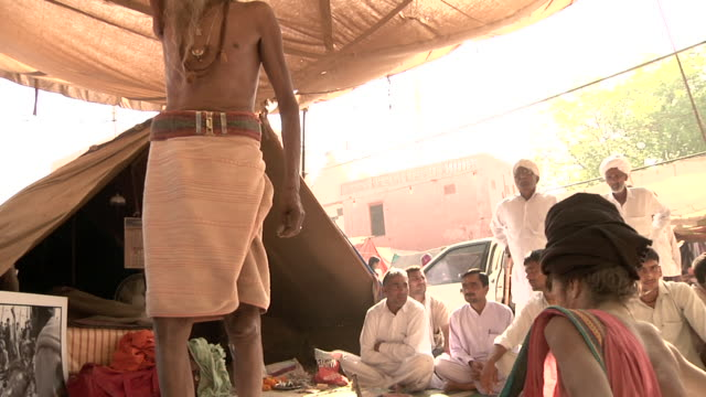 people sitting next to sadhu. - next to stock videos and b-roll footage