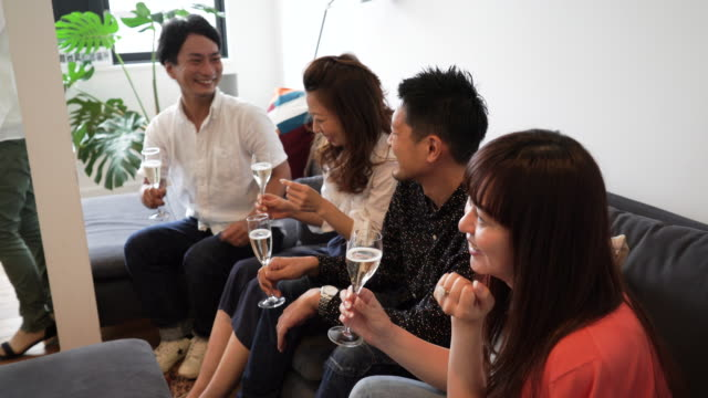 People sitting on couch while drinking wine