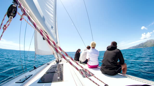 WS People Sitting On Deck Of Sailboat