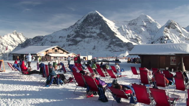 MS People sitting on lounge chair outside of restaurant at mannlichen / Grindelwald, Bernese Oberland, Switzerland