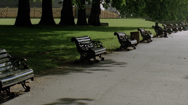 ms people sitting on park bench in park / london, uk - park bench stock videos & royalty-free footage