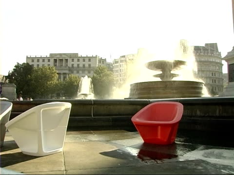 people sitting on polystyrene chairs in trafalgar square more of people sitting on chairs placed around trafalgar square with fountains beside - polystyrene stock videos & royalty-free footage
