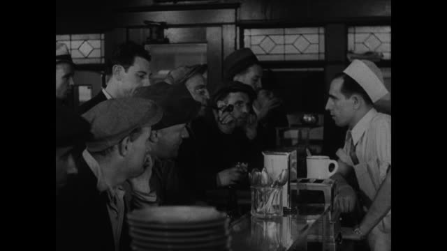 stockvideo's en b-roll-footage met people sitting on porch listening to radio, diner waiter turning up radio, men gathered at diner bar listening, taxicab drivers gathered around car... - 1930