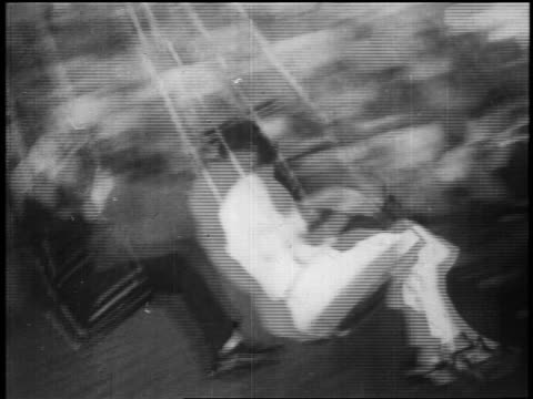 b/w 1928 pan people sitting on swing ride at coney island / nyc / documentary - 1928 stock videos & royalty-free footage