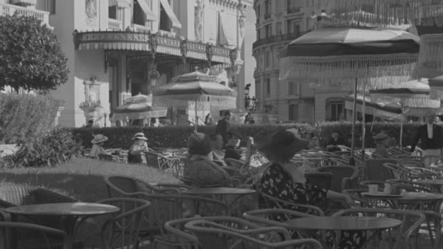 ms people sitting on tables at cafe de paris  - monaco stock videos & royalty-free footage