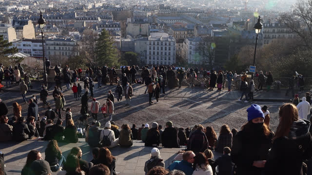 people sitting on the steps of the basilique du sacré-coeur in montmartre with a view of paris during the covid-19 epidemic on january 9 in paris,... - togetherness stock videos & royalty-free footage