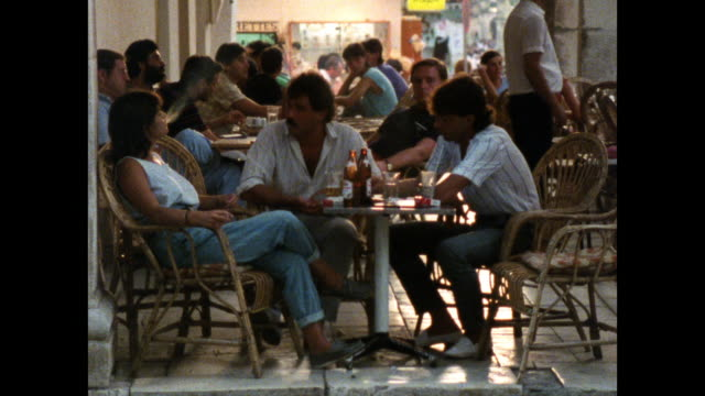 people sitting outside a cafe in corfu; 1986 - greece stock videos & royalty-free footage