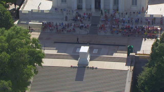 WS ZO AERIAL POV People sitting outside Arlington Memorial Amphitheater with tree area / Arlington County, Virginia, United States