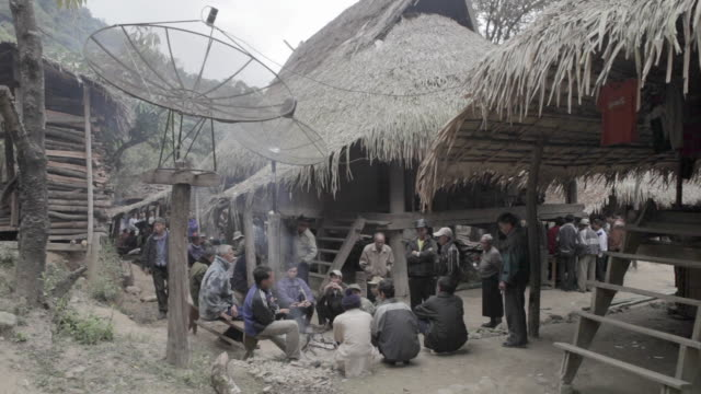 ws people sitting outside huts / xam neua, laos - laos stock videos and b-roll footage