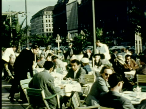 vidéos et rushes de ms people sitting  outside in hotel  audio / germany - 1956
