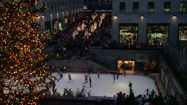 people skate at the ice rink of rockefeller center. - rockefeller center christmas tree stock videos & royalty-free footage