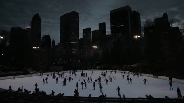 people skate at the wollman ice skating rink in central park at night on february 2 a time lapse shot of people ice skating at the wollman rink at... - ice skating stock videos & royalty-free footage