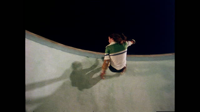 people skateboard in empty pool at night, california; 1978 - nostalgia stock videos & royalty-free footage