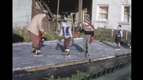 vidéos et rushes de 1955 montage people skating in backyard rink / toronto, canada - 1955