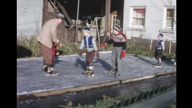 stockvideo's en b-roll-footage met 1955 montage people skating in backyard rink / toronto, canada - 1955