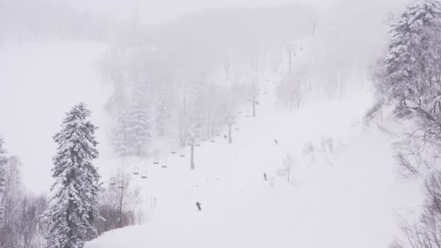 people skiing and snowboarding at ski resort. winter sport and vacation - slalom skiing stock videos & royalty-free footage