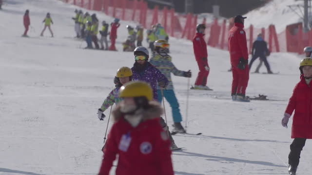 People skiing on the slopes of Pyeongchang South Korea