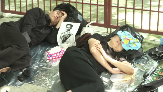 People sleep close to the Sanam Luang where the funeral and cremation of the late King of Thailand Bhumibol Adulyadej