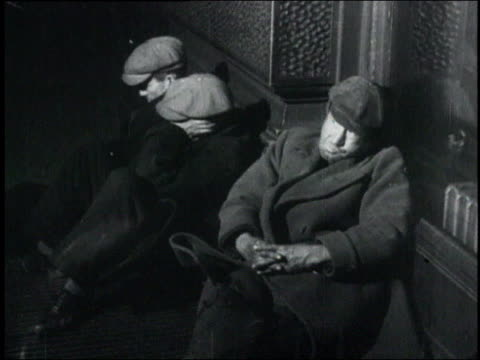 montage people sleeping on the ground leaning against walls / usa - 1932 stock-videos und b-roll-filmmaterial