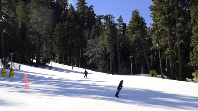 people snowboarding at mountain high - westwood neighborhood los angeles stock videos and b-roll footage