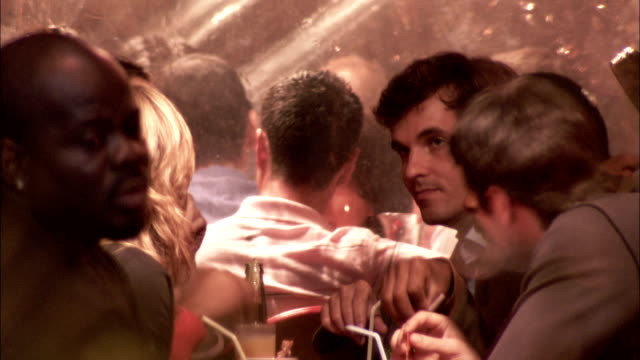 people socialise and sip their drinks at a cafe at night. available in hd. - straw stock videos & royalty-free footage