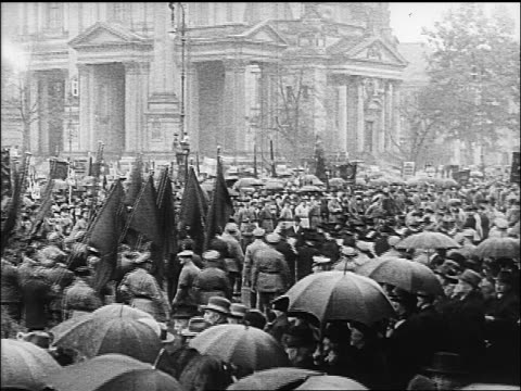 b/w 1918 people soldiers parading with flags in rain in large plaza of berlin / documentary - 1918 stock videos & royalty-free footage