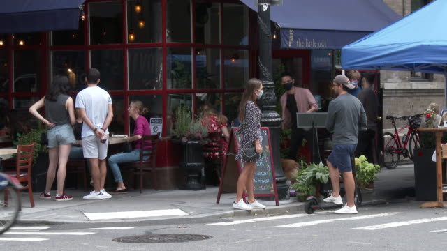 people some with protective face coverings on dine outdoors at the little owl restaurant at the intersection of grove and bedford streets on... - scott mcpartland stock videos & royalty-free footage
