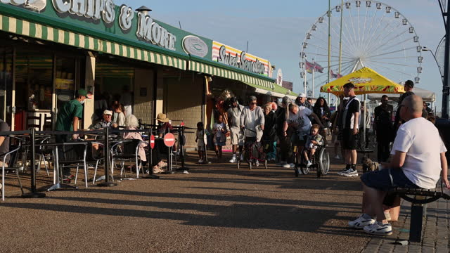 people spending time seaside as tourists stay in the uk because of covid travel restrictions, in great yarmouth, norfolk u.k. on wednesday, august 4,... - chair stock videos & royalty-free footage