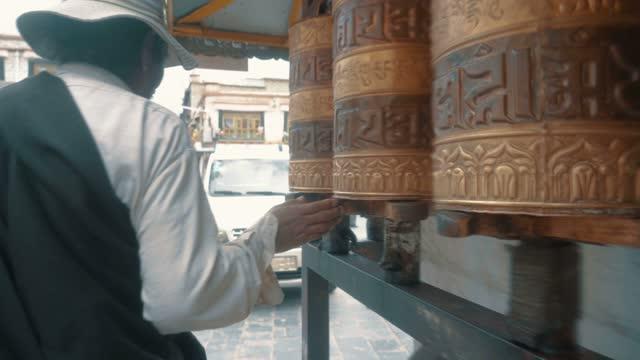 people spinning prayer wheels, lhasa, tibet, china - traditionally tibetan stock videos & royalty-free footage