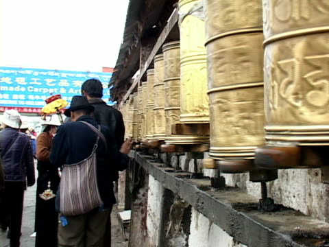 ms, people spinning prayer wheels, lhasa, tibet, china - non western script stock videos & royalty-free footage