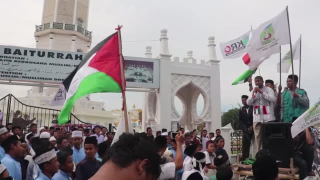 People stage a protest against US President Donald Trump's recognition of Jerusalem as Israel's capital at Baiturrahman Grand Mosque in Aceh...