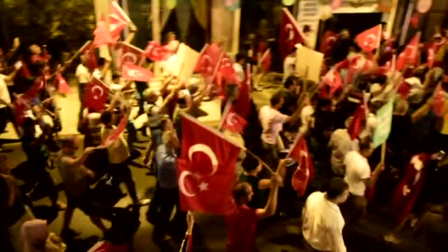 people stage a rally to protest against parallel state/gulenist terrorist organization's failed military coup attempt in mugla turkey on july 24 2016... - staatsstreich stock-videos und b-roll-filmmaterial