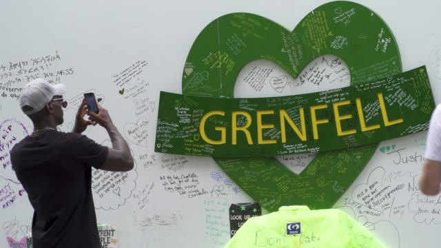 people stand and pay their respects in front of a wall where messages of support have been written surrounding grenfell tower in west london on june... - domestic kitchen stock videos & royalty-free footage