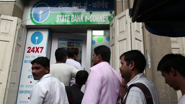 People stand in a queue to exchange one thousand and five hundred rupee banknotes outside a Post office in Mumbai India on Friday Nov 18 Customers...