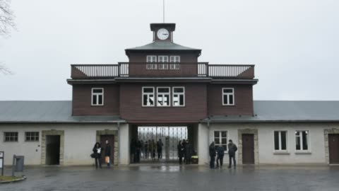 people stand in front of the former main entrance to the buchenwald concentration camp on january 26, 2018 near weimar, germany. international... - weimar stock videos & royalty-free footage