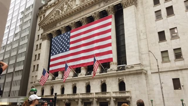 people stand in front of the new york stock exchange following news that deutsche bank will be letting go of thousands of employees due to a major... - deutsche bank stock videos & royalty-free footage