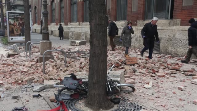 people stand on the streets and several building are damaged after a 53 magnitude earthquake hit zagreb croatia on march 22 2020 a 53 magnitude... - zagreb stock videos & royalty-free footage