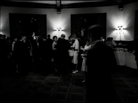 / people standing about circulating serving themselves from buffet / people chatting with each other eating reception at hélène de champlain... - カップ点の映像素材/bロール