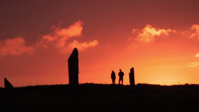 ws people standing at ring of brodgar at sunset / orkney, scotland, united kingdom - prehistoric era stock videos & royalty-free footage